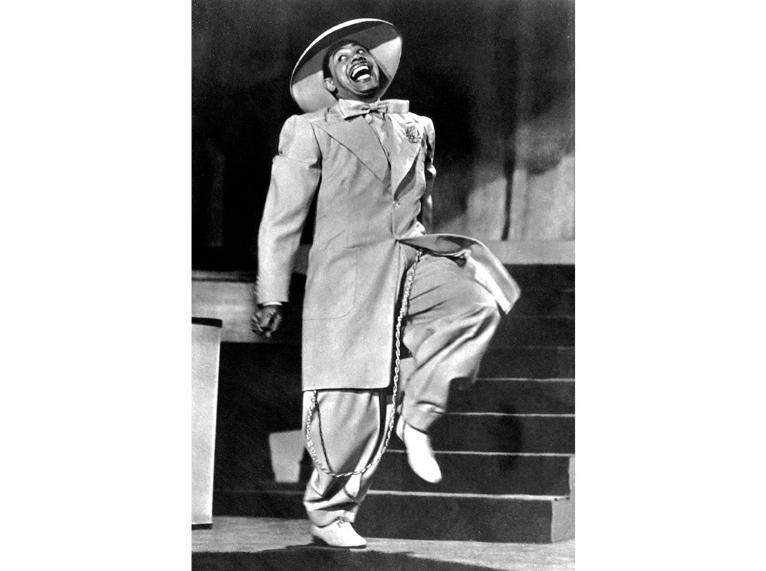 zoot suit Popular colthing worn in the swing era of the 20's - 40's where jazz was the dominant style of music typically worn by jazz cats jacket characterized by broad shoulders, large lapels, and longer than a normal suit jacket.